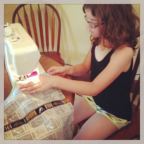 Photo: 4H Fair judging starts in 2 days! Taking the day off to get the last minute touches on a few projects. Today, it is finished her sewing non-wearable. A Purdue pillow!